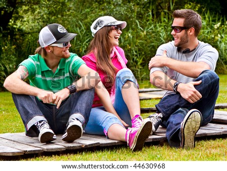 three teenager spending leisure together - stock photo