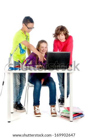 Three teenagers are helping each other with there homework
