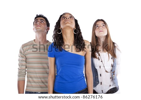 Three teenagers friends looking up to the copy space (isolated on white) - stock photo