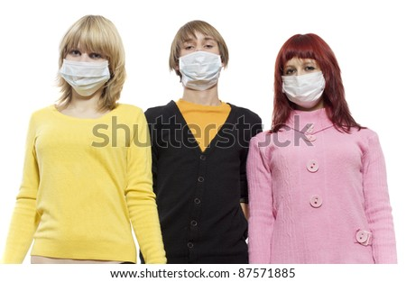 Three teenagers in protective respirator bandage on - stock photo
