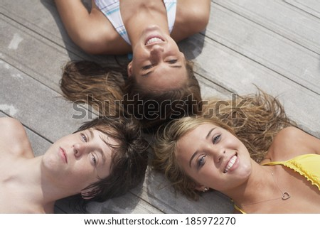 Three Teenagers Lying in Circle