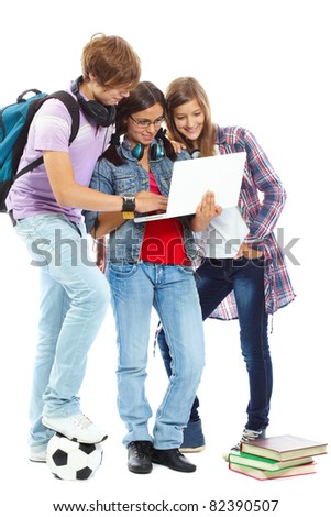 Three teenagers studying with laptop - stock photo