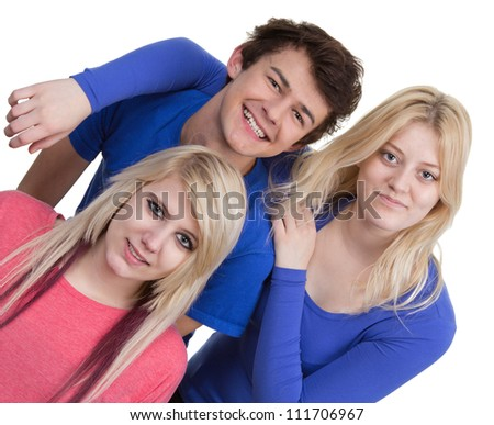Three teenagers together in a group, isolated on white. Photo taken at 45 degree angle.