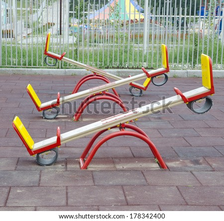 Three teeter totters. Shot on a playground - stock photo