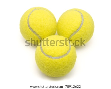 Three Tennis Balls in triangle shape - stock photo