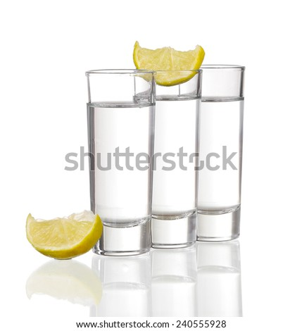 Three  tequila shots with lime isolated on white background