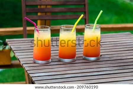 Three tequila sunrise cocktails - stock photo