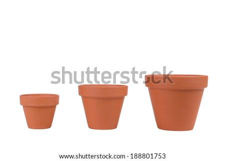 Three terracotta planters of different sizes on white.