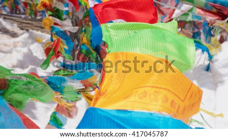 Three Tibet style pagoda and colourful prayer flag in top of snow mountain at shangri-la, Yunnan , China.