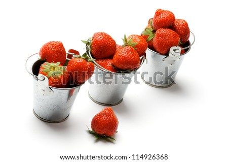 Three Tin Buckets with Perfect Ripe Strawberry in a Row isolated on white background - stock photo