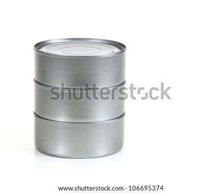 Three tin cans stacked up with no label on white - stock photo
