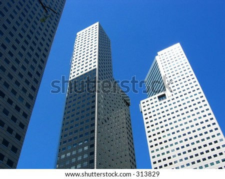 Three towers of Suntec City on a clear blue sky - stock photo