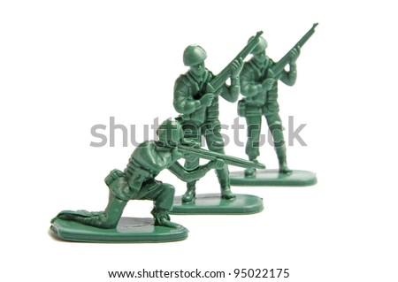 Three toy soldiers on a white background