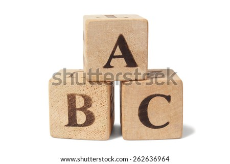 Three toy wooden blocks with letters ABC on them - stock photo