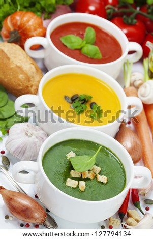Three traditional soups (tomato, pumpkin and  spinach). Traffic light concept - stock photo
