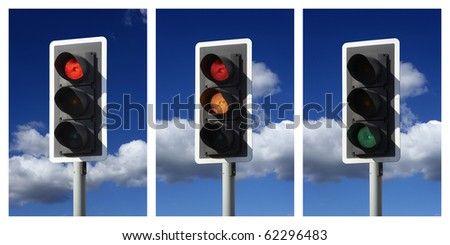 three traffic lights showing sequence red amber green - stock photo