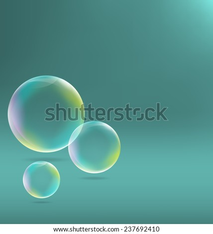 Three transparent soap bubbles with shadows on cyan background - stock photo