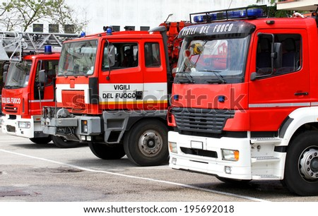 three trucks of Italian firefighters ready for every emergency - stock photo