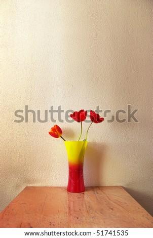 Three tulip in vase. Decoration in room. - stock photo