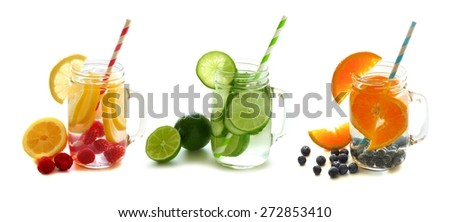 Three types of healthy detox water with fruit in mason jars isolated on a white background - stock photo