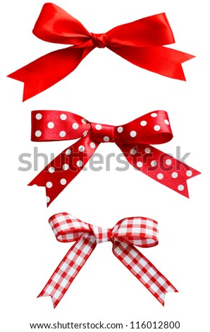 Three types of isolated red ribbon bows on white background.  One plain, two patterned with polka dots and checks. - stock photo
