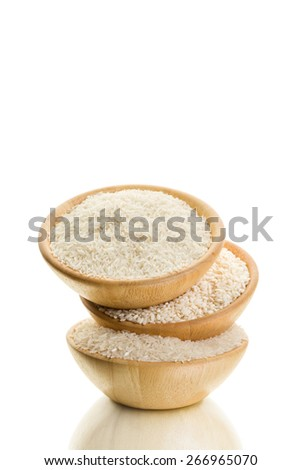 Three types of rice in a wooden bowl on a white background - stock photo