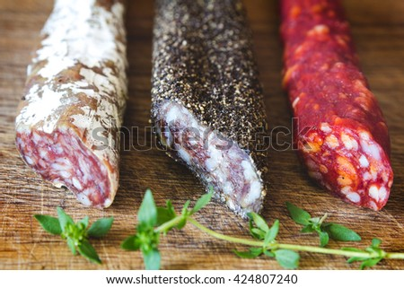 Three types of spanish sausages on wooden board - stock photo