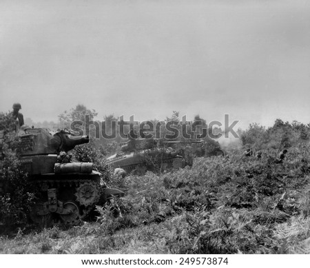 Three U.S tanks firing on German positions in the Battle of the Falaise Pocket. The Location is near Barenton, Normandy, where the German counter offensive was stopped on August 17, 1944. - stock photo
