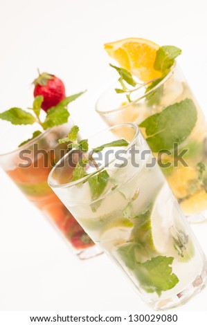 Three variation of Mojito cocktails, a Cuban cocktail made with cuban rum, lime, sugar, a splash of soda and flavoured with fresh fruit of your choice - stock photo