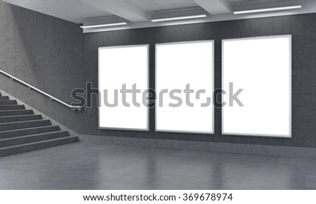 Three vertical billboards in the underground, stairs up to the left. Grey walls. Concept of underground advertising. 3D rendering