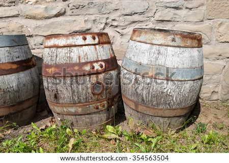 Three Vintage Plugged Beer Barrels Outdoors at Museum - stock photo