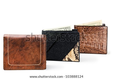 Three wallets made of genuine leather over white background - stock photo