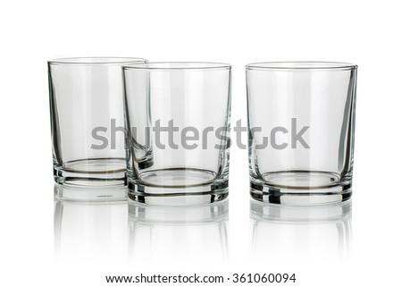 three whiskey glasses isolated - stock photo