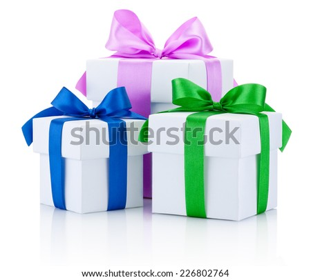 Three White boxs tied with colored satin ribbons bow Isolated on white background - stock photo