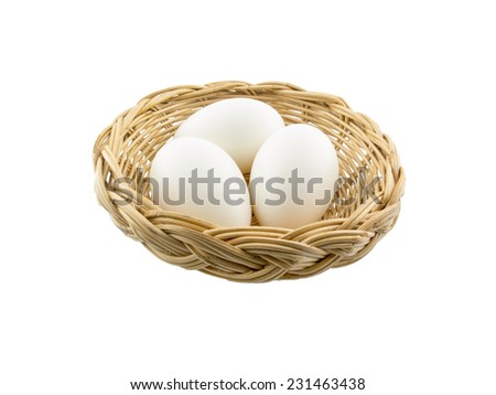 three white eggs in the basket