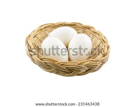three white eggs in the basket - stock photo