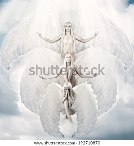 Three white female angels with big wings  - stock photo