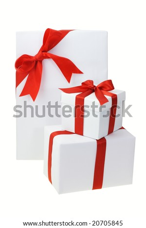 Three white gift boxes with red bow ribbons on white