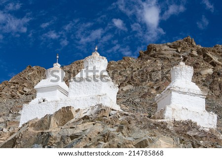 Three white pagoda near Shanti Stupa is a Buddhist white-domed stupa in Leh, India  - stock photo