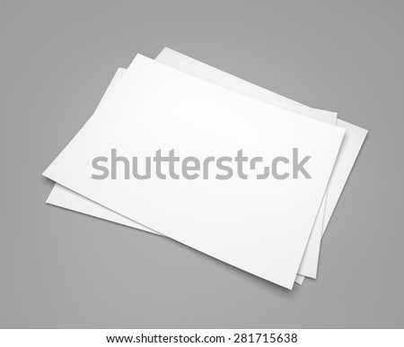 Three white paper sheets on gray background - stock photo