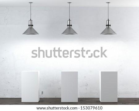 Three white stands in interior - stock photo
