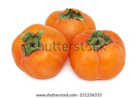 Three whole persimmons isolated on white background