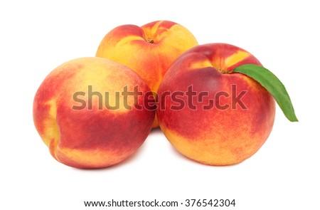 Three whole ripe nectarines isolated on white background - stock photo