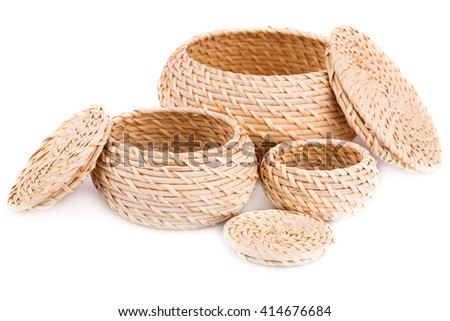 Three wicker boxes isolated on white background. - stock photo