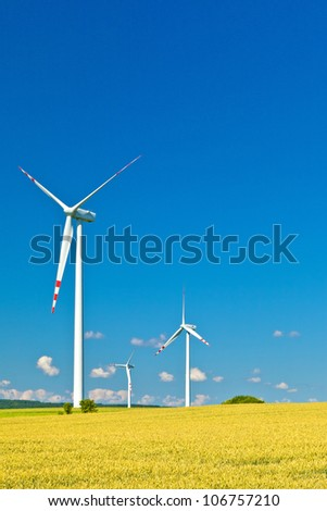 three wind turbines and blue sky