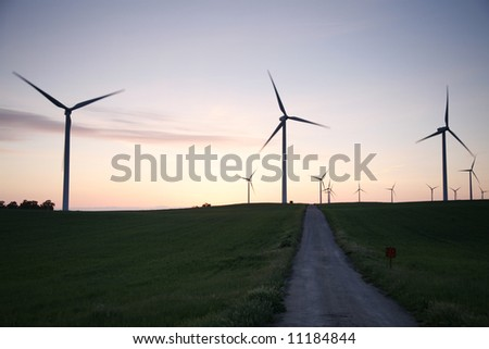 three windmills and a road