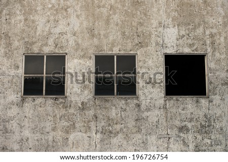 Three windows in old wall - stock photo