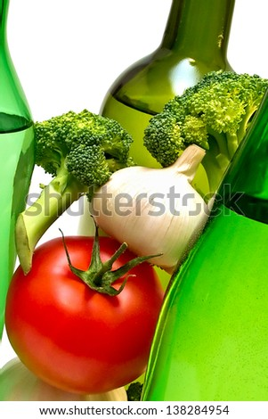 three wine bottles and vegetables - stock photo