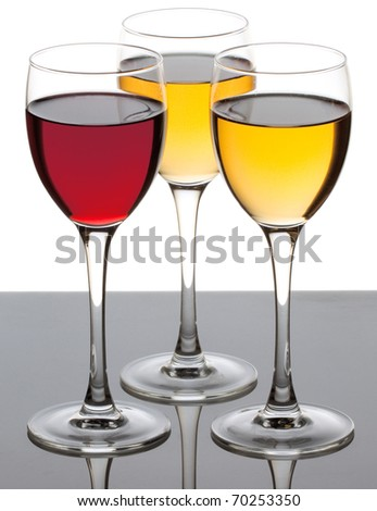 Three wine glass with red and white wine over white background