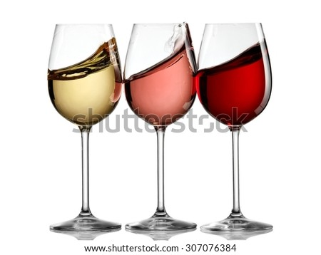 Three wine glasses plash - stock photo
